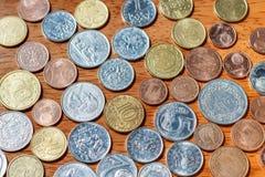 Verschillende de muntstukken van landen macro als achtergrond Stock Foto