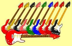 Verschillende elektrische gitaren in verschillende kleuren met achtergrond Royalty-vrije Stock Foto