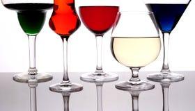 Verschillende gekleurde dranken Stock Foto's