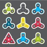 Verschillende gekleurde spinners Stock Foto's