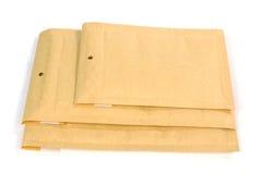 Verschillende grootte drie bel gevoerde het verschepen of verpakkingsenveloppen Stock Afbeeldingen