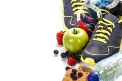 Verschillende hulpmiddelen voor sport en gezond voedsel Stock Foto