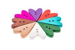 Verschillende kleurenhart gevormde naaiende knopen in een bloemvorm Stock Foto's