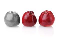 Verschillende kleurloze appel met twee rode degenen Royalty-vrije Stock Afbeeldingen