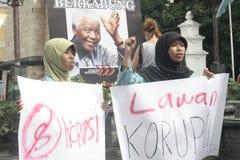 Verschleiern des gemischten Protestes gegen Korruption in der Solo- Stadt lizenzfreie stockfotografie