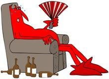 Verschwitzter roter Teufel, der in einem Stuhl sitzt Stockbilder