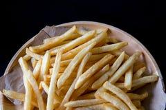 Verse Aardappels Smakelijke frieten met ketchup snelle voedingsmiddelen Royalty-vrije Stock Afbeeldingen