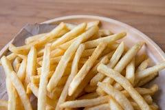 Verse Aardappels Smakelijke frieten met ketchup snelle voedingsmiddelen Royalty-vrije Stock Foto's
