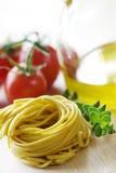 Verse deegwaren en ingrediënten Stock Foto