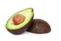 Verse die avocadoplak op witte achtergrond wordt geïsoleerd stock foto
