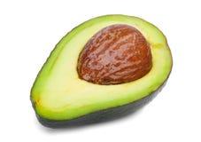 Verse en gezonde die avocado in de helft wordt gesneden Groene gesneden avocado op een witte achtergrond Exotische groenten naugh Royalty-vrije Stock Foto
