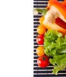 Verse groenten op een zwart servet Stock Afbeelding