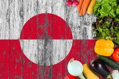 Verse groenten van Groenland op lijst Het koken concept op houten vlagachtergrond royalty-vrije stock fotografie