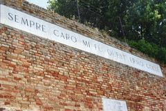 Verse of the Infinte, famous poem of Leopardi in Recanati. Verse of the Infinte, the most famous poem of Giacomo Leopardi on a wall cartel in Recanati, Marche Stock Images