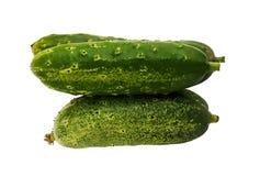 Verse Komkommer op witte achtergrond stock foto's