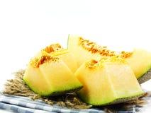 Verse meloenen die op witte achtergrond worden gesneden Royalty-vrije Stock Afbeeldingen