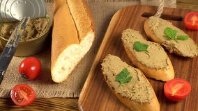 Fresh pate with bread on wooden table Stock Footage