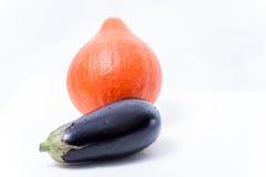 Verse pompoen en aubergines royalty-vrije stock fotografie