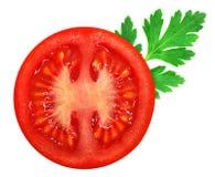 Verse rode tomaat met peterselieblad Royalty-vrije Stock Afbeelding