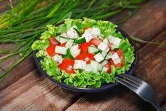 Verse salade met tomaat en komkommer Stock Fotografie