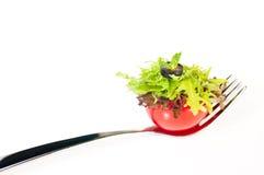 Verse tomaat en salade canape op een vork Stock Foto