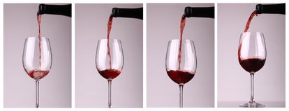 Versement de vin rouge Photos stock