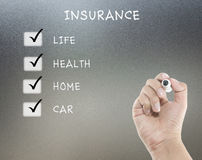 Versicherung auf Glasbrett Stockfotografie
