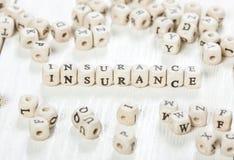 Versicherungswort geschrieben auf hölzernen Block Lizenzfreies Stockfoto