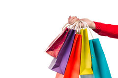 Versicolored and bright shopping packages hanging on female red- Stock Photography