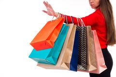 Versicoloured and bright shopping packages hanging on female red Stock Photos