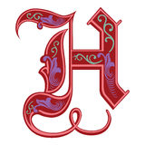 Versierde Gotische stijldoopvont, brief H Stock Foto