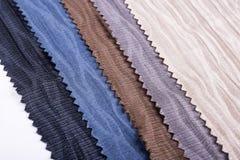 Versieringen van stof in verschillende kleuren royalty-vrije stock afbeeldingen