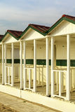 Versilia beach cabins on the sunset Royalty Free Stock Images