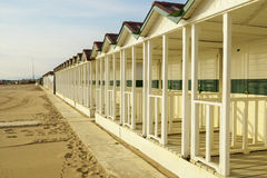 Versilia beach cabins on the sunset Royalty Free Stock Photography