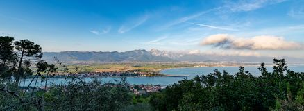 Versilia coast and Apuan Alps - Italy. Versilia coast with the Magra river, the Ligurian sea, the Apennines and the Apuan Alps. Tuscany, Liguria, Italy, Europe Royalty Free Stock Photography