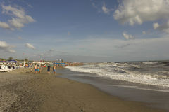 Versilia coastline at day time in summer season. MARINA DI MASSA, ITALY- AUGUST 17 2015: Versilia coastline at day time in summer season, with people around the Stock Photography
