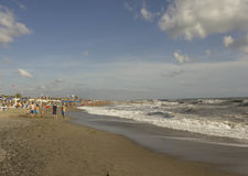 Versilia coastline at day time in summer season. MARINA DI MASSA, ITALY- AUGUST 17 2015: Versilia coastline at day time in summer season, with people around the Royalty Free Stock Images