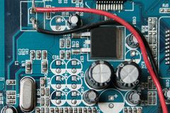 Version 3, Blue electronic circuit close-up. Royalty Free Stock Images