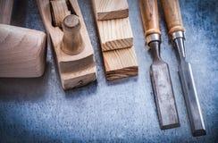 Versione orizzontale dei mattoni di legno del martello della piallatrice Fotografia Stock
