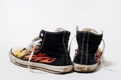 Versleten Tegenovergestelde All Star-schoenen Stock Fotografie
