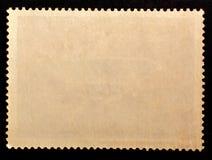 Verso afixado do selo da textura do grunge papel velho isolado no fundo preto Copie o espaço imagem de stock royalty free