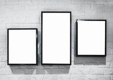 Verspotten Sie herauf Leuchtkastenrahmen deisgn auf weißer Backsteinmauer Lizenzfreie Stockfotografie