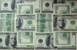 Verspreide bankbiljetten van 100 Amerikaanse dollars Stock Foto