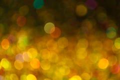 Verspreide gouden en gele bokeh Royalty-vrije Stock Afbeelding
