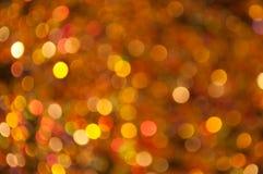 Verspreide gouden oranje en rode bokeh Stock Afbeeldingen