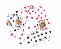 Verspreide speelkaartenachtergrond Royalty-vrije Stock Afbeeldingen