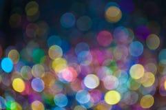 Verspreide veelkleurige schitterende bokeh achtergrond Royalty-vrije Stock Foto's