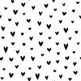 Verspreide zwarte harten op witte achtergrond Royalty-vrije Stock Afbeeldingen