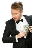 Versteckendes Bargeld des Geschäftsmannes Stockfotografie