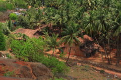 Versteckte Häuser in landwirtschaftlichem Indien Stockbilder